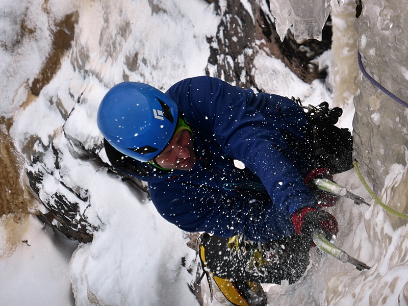 Bayard nearly at the belay after climbing the overhang section and weaving through the ice dagger.