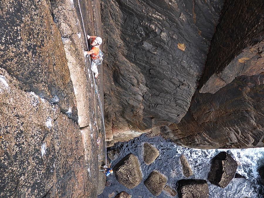 Tim Neill climbing pitch one of Immaculata, Holy Jaysus Wall, Owey.