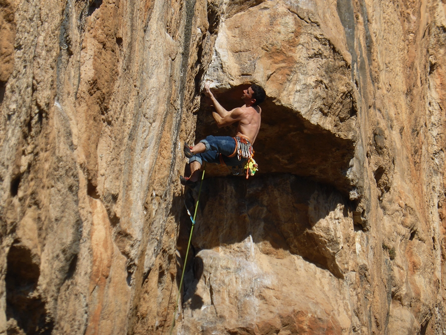 Unknown climber passing the final roof of the brilliant 35m, 7c Los Franceses. This is the point the climb turns from an E4 into 7c!