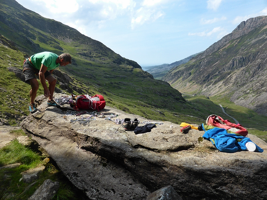 Mick Lovatt, (TPM) gearing up on the flat rock beneath the crag.