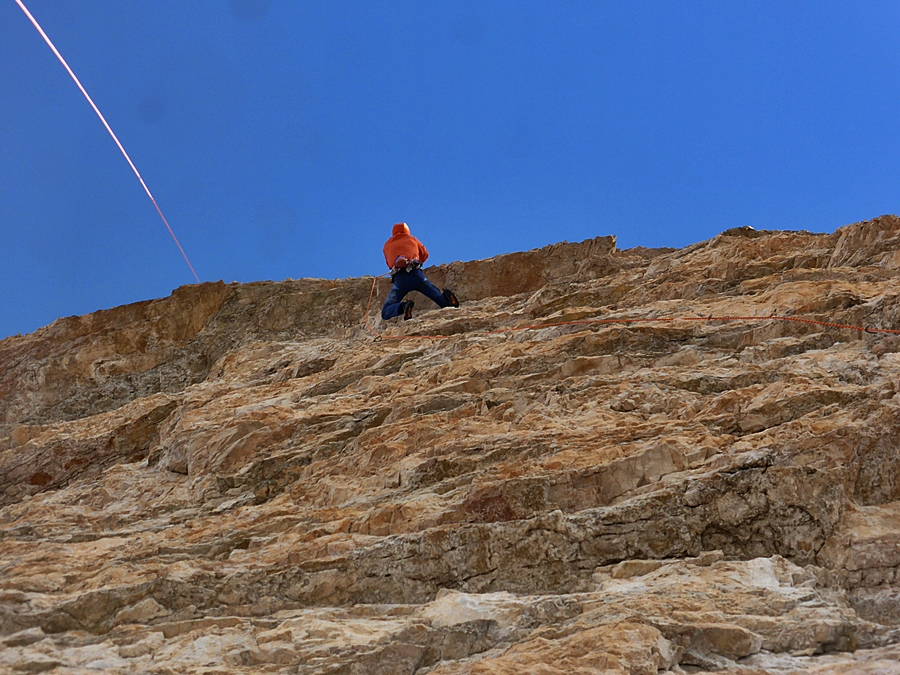 Matt pulling the roof on the easier section of the sixth 7c pitch of Pressknödel.