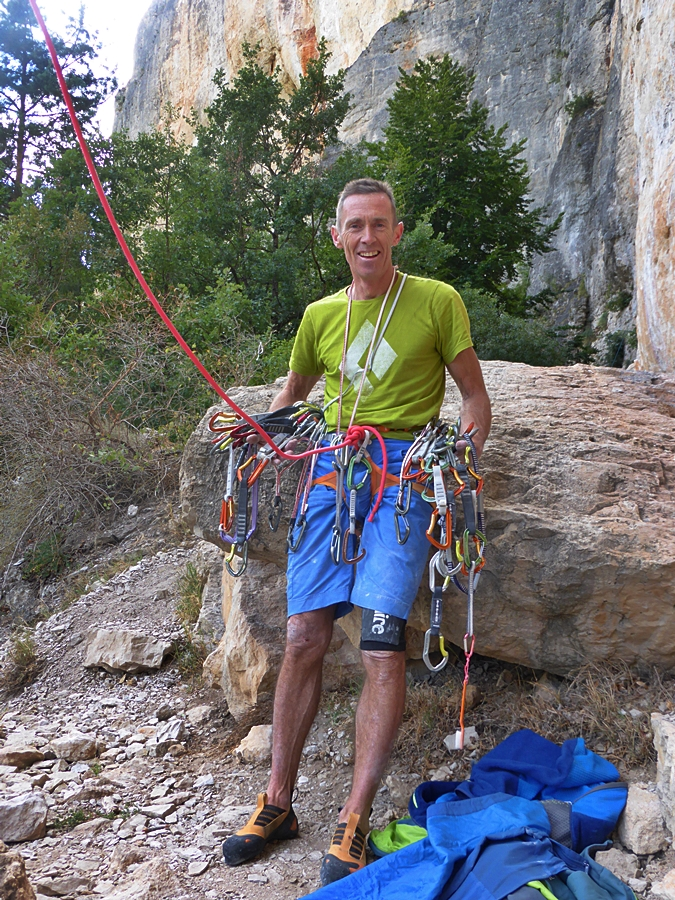 A happy man with a pile of stripped gear. It took us so long to climb this route clean its a wonder the gear hadn't rusted!