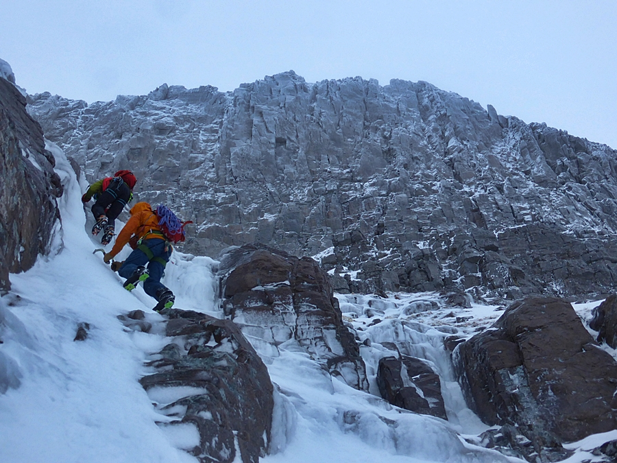 Matt Stygall and Tim Neill soloing easy ice to reach the foot of Beinn Eighe's East Buttress.