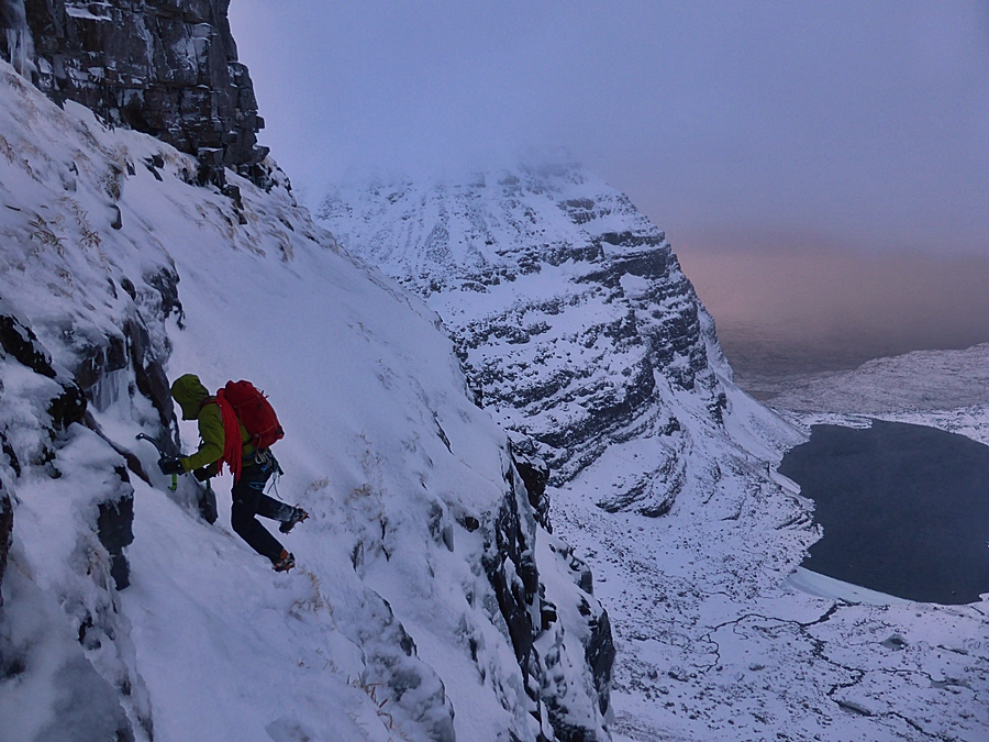 Tim Neill traversing the East Buttress to find the beginning of the route.